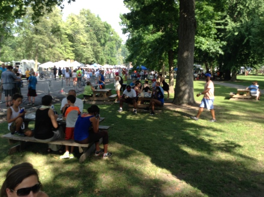 The crowds at the Festival of Nations enjoying the ethnic foods and warding off the stifling heat.